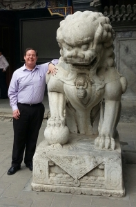 They say everything is bigger in Texas. It's even bigger in Beijing. Here I am with one of the campus' lions.