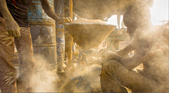"One of the many vivid photos from ""Tarnished."" This is from Larry Price's trip to a gold mining area of Burkina Faso."