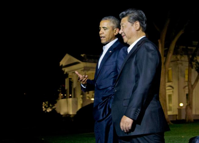Presidents Obama and Xi walk from the White House to Blair House for dinner on Sept. 24.